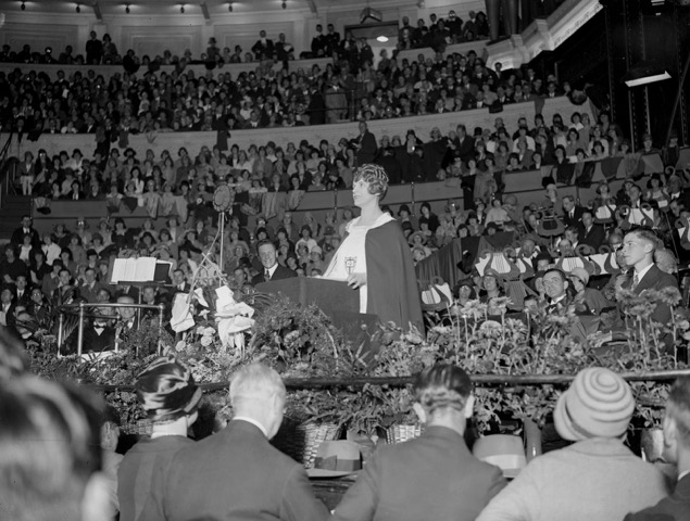 Aimee Semple McPherson leading her congregation in Los Angeles at Angelus Temple.